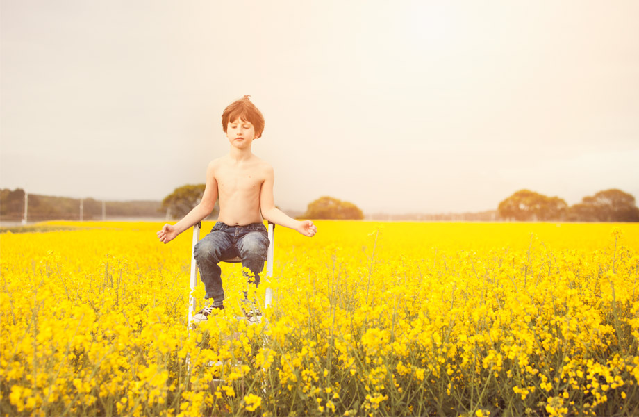 Environmental portraiture -Kent-and-Sussex-little boy-in-yellow-field-