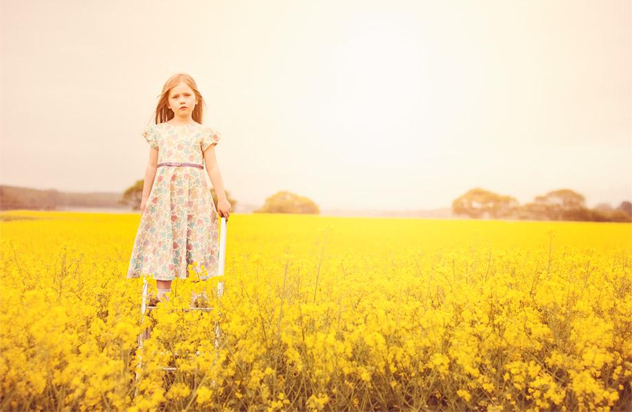 Little-girl-in-a-yellow-field-in-a-Sue-Hill-dress