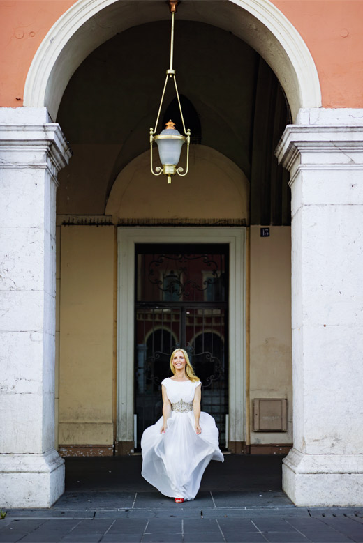 fashion blogger wearing white catherine dean dress