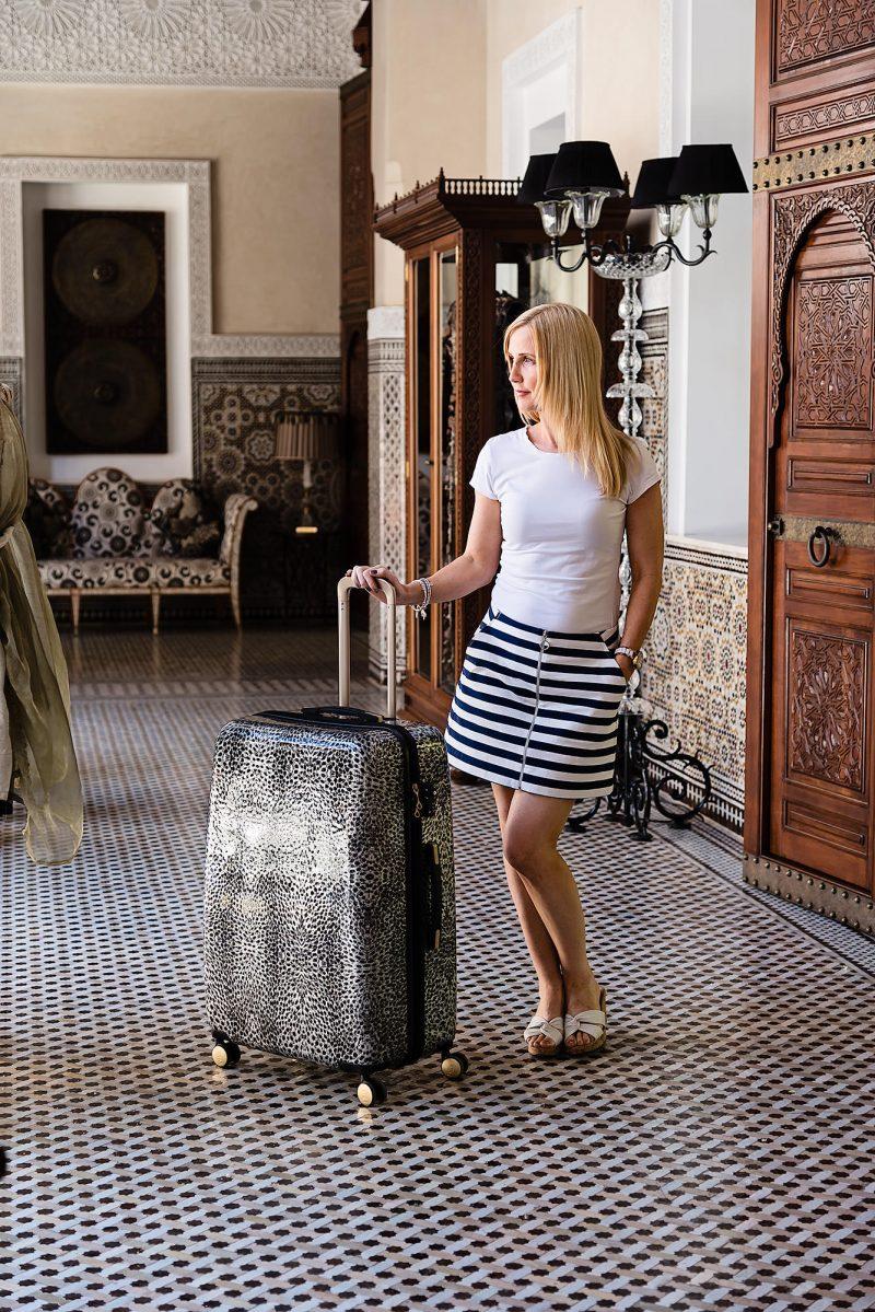 fashion-blogger-with-animal-print-biba-suitcase_mini